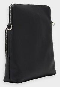 Calvin Klein Jeans - MICRO PEBBLE FLAT PACK - Across body bag - black - 1