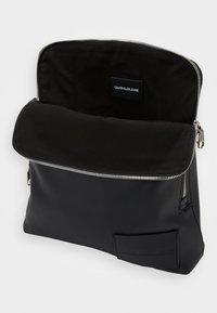 Calvin Klein Jeans - MICRO PEBBLE FLAT PACK - Across body bag - black - 2