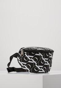 Calvin Klein Jeans - MIRRORED MONOGRAM WAIST PACK - Bandolera - black - 4