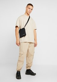 Calvin Klein Jeans - MONOGRAM MICRO  - Across body bag - black - 1