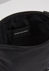 Calvin Klein Jeans - MONOGRAM MICRO  - Across body bag - black - 4