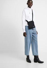Calvin Klein Jeans - MONOGRAM MICRO  - Across body bag - black - 5