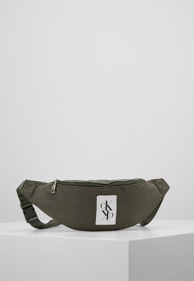 SPORT ESSENTIALS STREET PACK - Bum bag - green