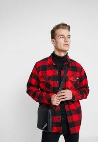 Calvin Klein Jeans - STITCH MICRO - Borsa a tracolla - black - 1