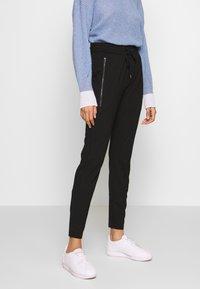 comma casual identity - Pantalones deportivos - black - 0
