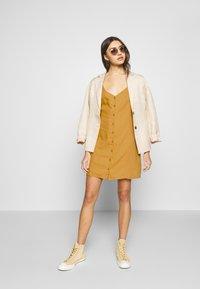 Cotton On - AURORA SHORT SLEEVE MINI DRESS - Košilové šaty - mineral yellow - 1