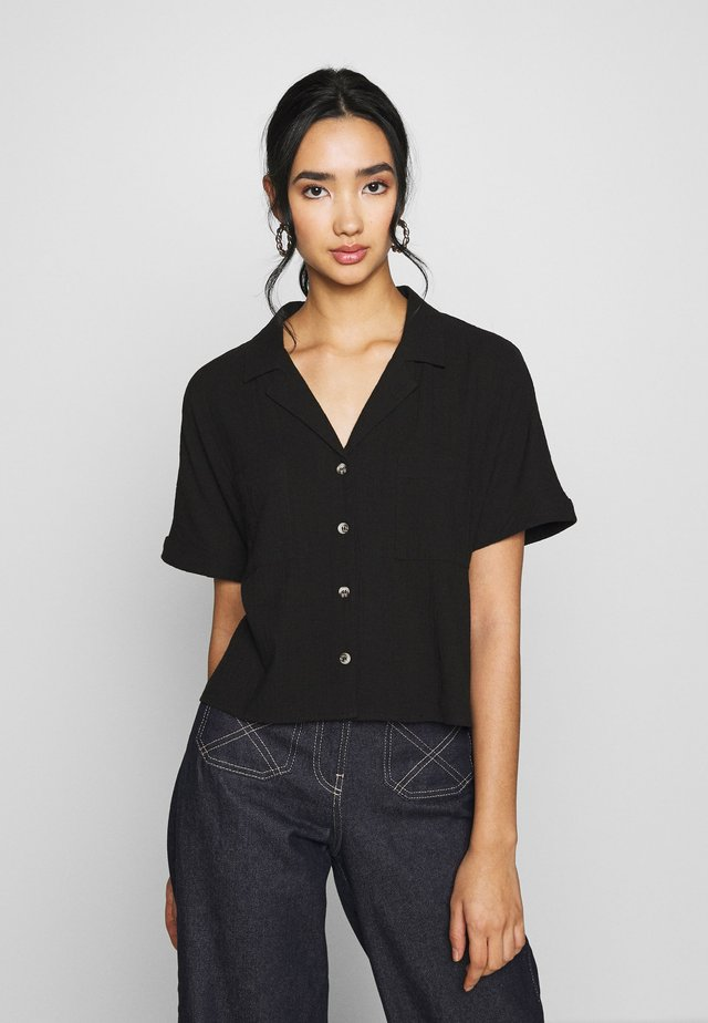 ERIKA SHORT SLEEVE - Button-down blouse - black