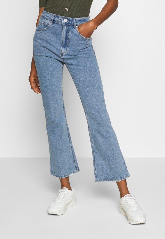 HIGH RISE GRAZER - Flared Jeans - light-blue denim