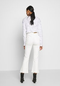 Cotton On - HIGH RISE GRAZER - Flared Jeans - white - 2