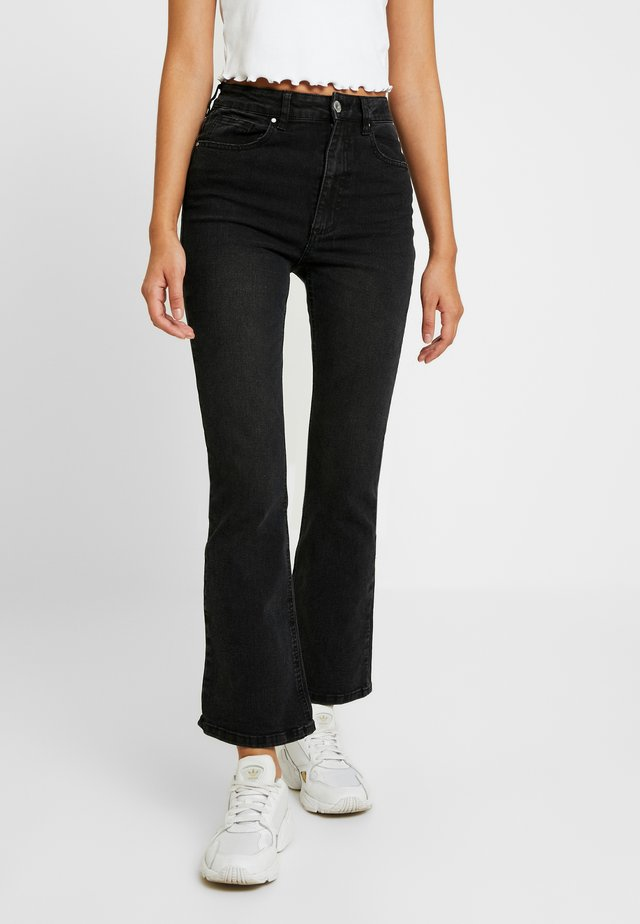 HIGH RISE GRAZER - Flared jeans - black