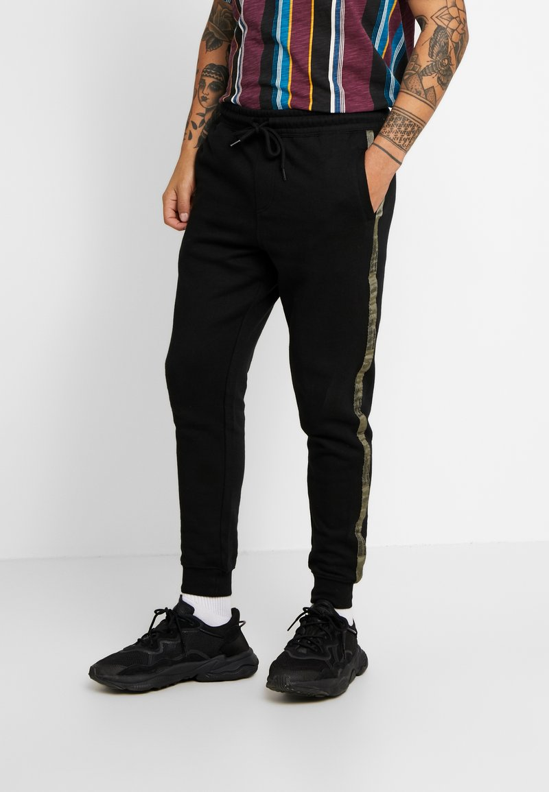 Cotton On - TRIPPY TRACKIE - Tracksuit bottoms - black