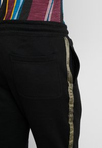 Cotton On - TRIPPY TRACKIE - Tracksuit bottoms - black - 5