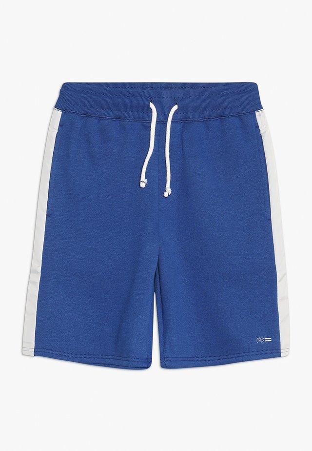 TEEN SPORTS - Tracksuit bottoms - blue