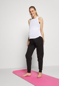 Cotton On Body - MATERNITY GYM TRACKIE - Tracksuit bottoms - black - 1