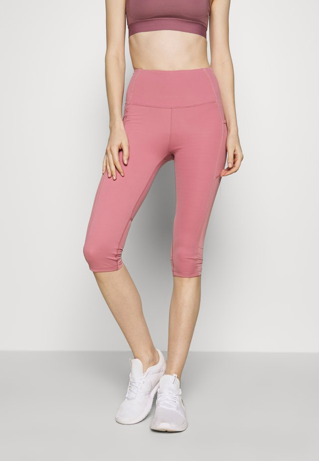 BINDED CAPRI - 3/4 sports trousers - washed rose
