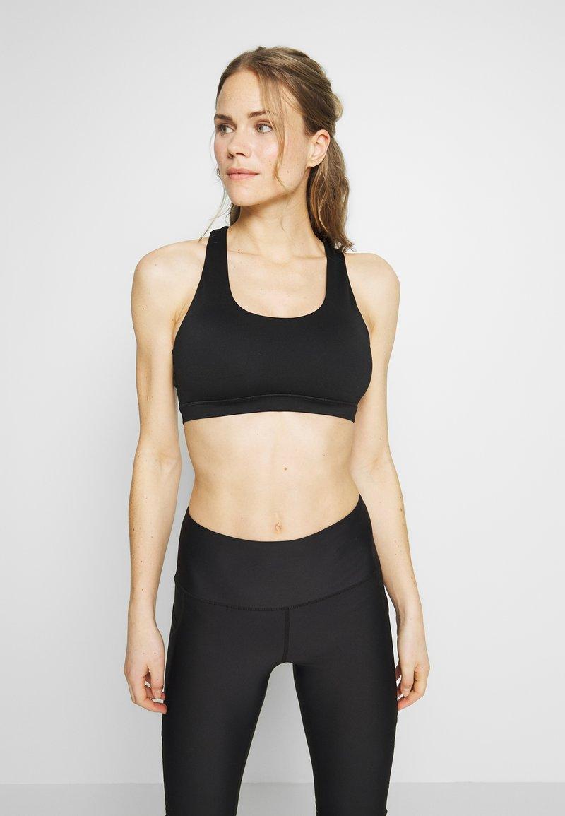 Cotton On Body - WORKOUT CUT OUR CROP - Sujetador deportivo - black