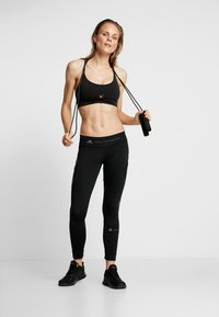 Cotton On Body - GYM TO SWIM STRAPPY CROP - Reggiseno sportivo - black - 1