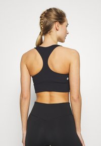 Cotton On Body - CUT OUT CROP - Sport BH - black - 2