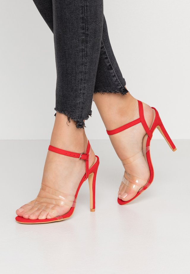 High heeled sandals - red/clear
