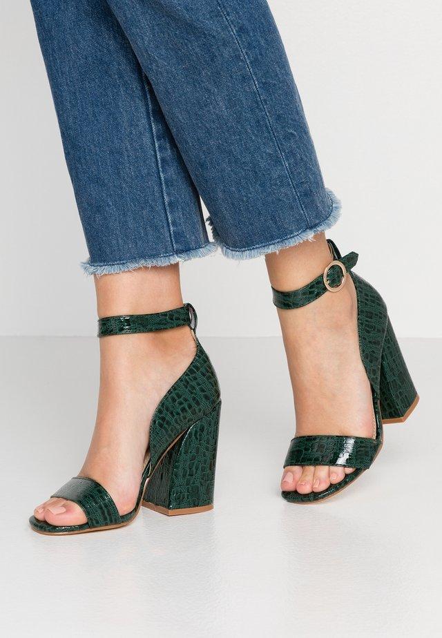 High heeled sandals - green