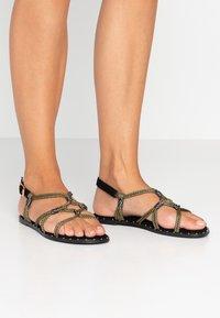 co wren wide fit - Sandals - black/gold - 0