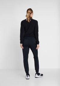 Columbia - FIRWOOD CAMP PANT - Trousers - black - 2