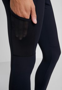 Columbia - WINDGATES LEGGING - Leggings - black