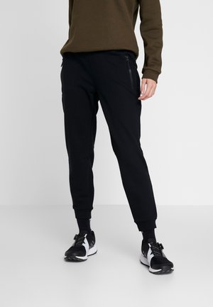 LODGE JOGGER - Tracksuit bottoms - black