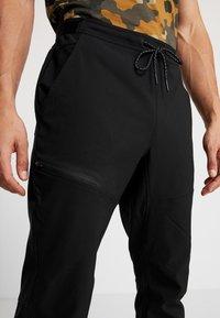 Columbia - TECH TRAIL FALL PANT - Długie spodnie trekkingowe - black - 3