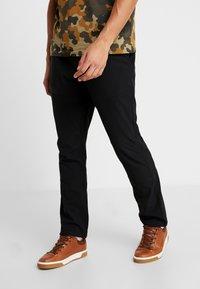 Columbia - TECH TRAIL FALL PANT - Długie spodnie trekkingowe - black - 0