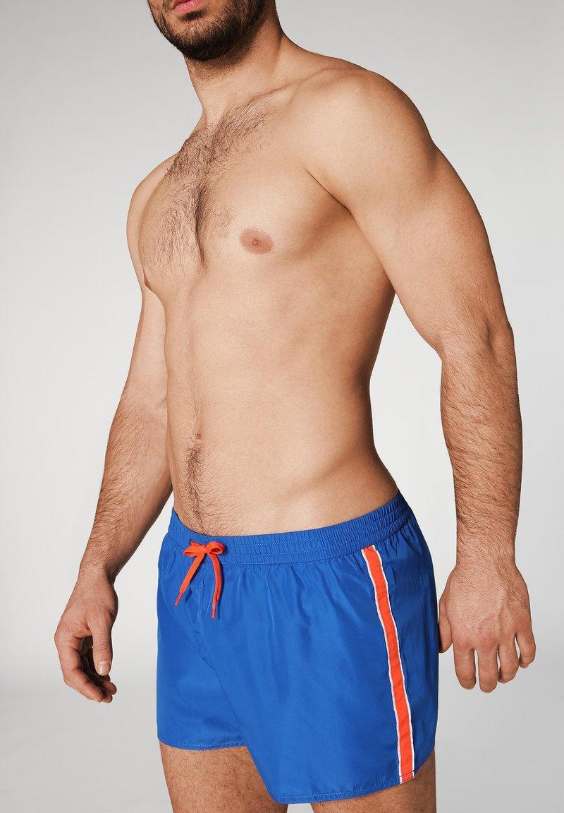 Calzedonia - IBIZA - Swimming shorts - blue wave/white/orange