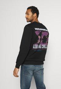 CORELLA - CORELLA WARNING - Sweater - black - 0