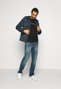 CORELLA - CORELLA WARNING - Sweater - black - 1
