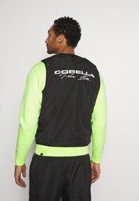 CORELLA - UTILITY VEST - Bodywarmer - black/white - 2