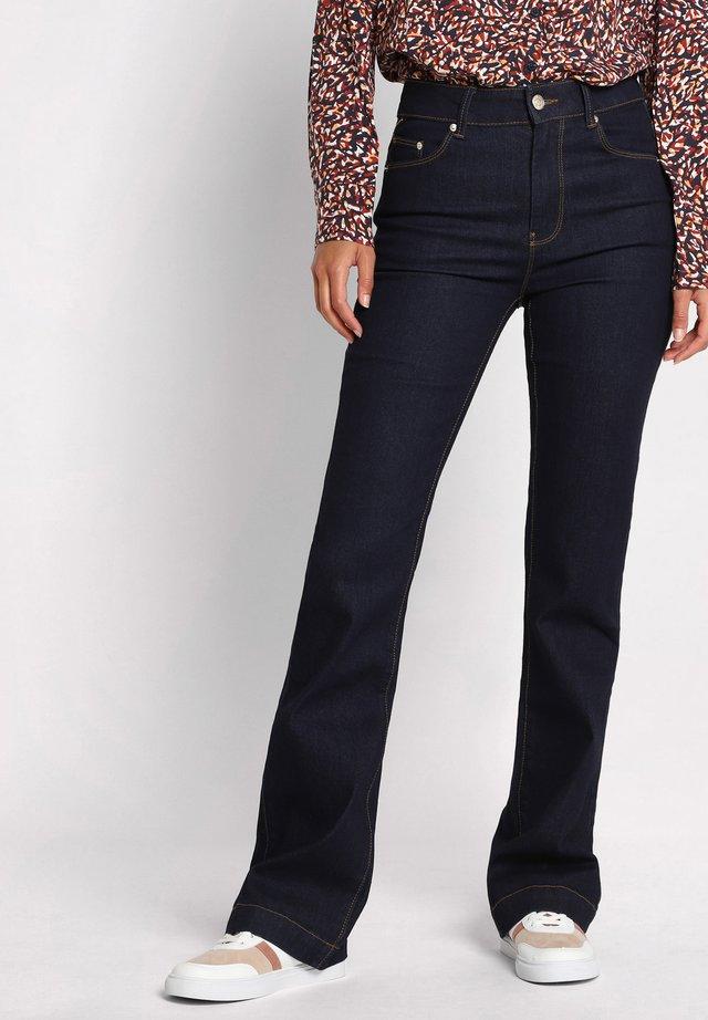 Jean bootcut - denim brut