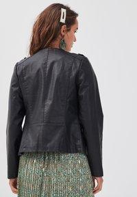 Cache Cache - MIT REISSVERSCHLUSS - Faux leather jacket - black - 2