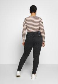 Calvin Klein Jeans Plus - PLUS HIGH RISE SKINNY ANKLE - Jeans Skinny Fit - black - 2