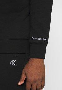 Calvin Klein Jeans Plus - PLUS ESSENTIAL - Sweatshirt - black - 5