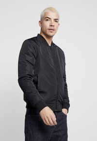Common Kollectiv - UNISEX UTILITY SMASH JACKET - Blouson Bomber - black - 2