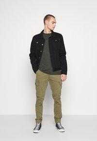 Common Kollectiv - UNISEX DISTRESS JACKET - Denim jacket - black - 1