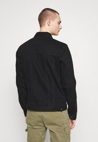 Common Kollectiv - UNISEX DISTRESS JACKET - Denim jacket - black - 2
