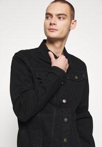 Common Kollectiv - UNISEX DISTRESS JACKET - Denim jacket - black - 3