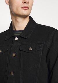 Common Kollectiv - UNISEX DISTRESS JACKET - Denim jacket - black - 5