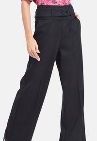 Chemins Blancs - SAVEUR  - Pantalon classique - black - 2