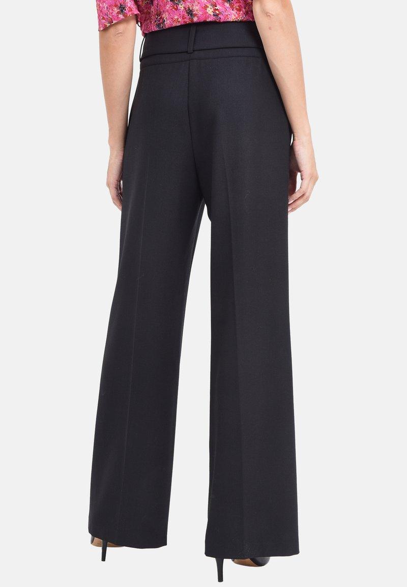 Chemins Blancs - SAVEUR  - Pantalon classique - black
