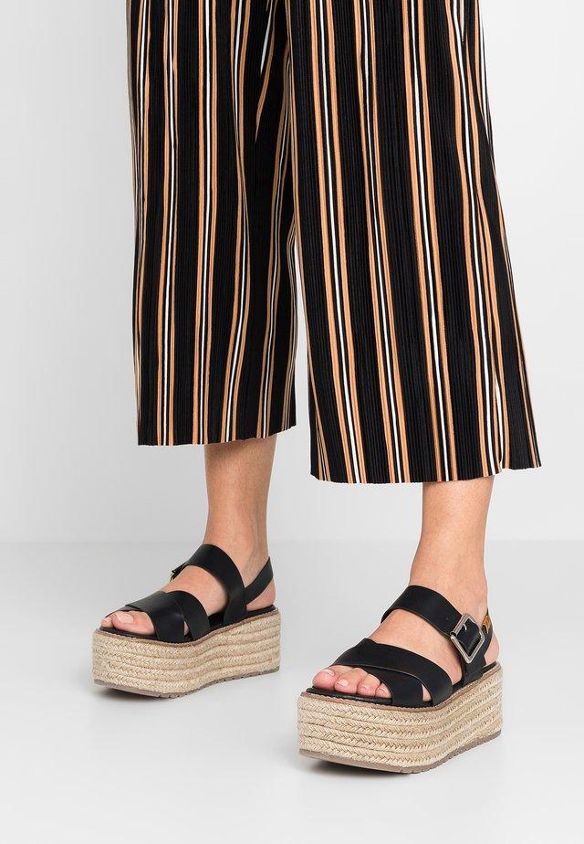 CECIL - Platform sandals - black