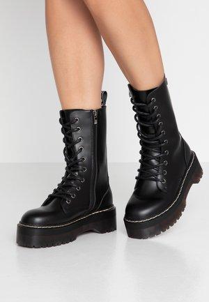 ABRIE - Platform boots - black