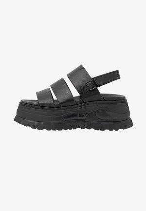GROUND - Korkeakorkoiset sandaalit - black