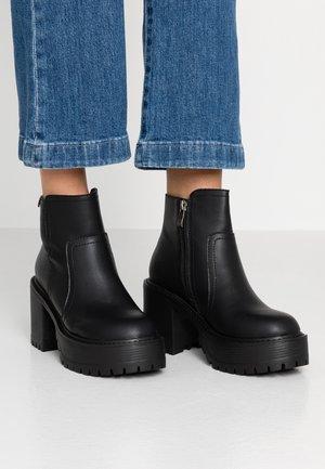 BORNISE - Ankelboots med høye hæler - black