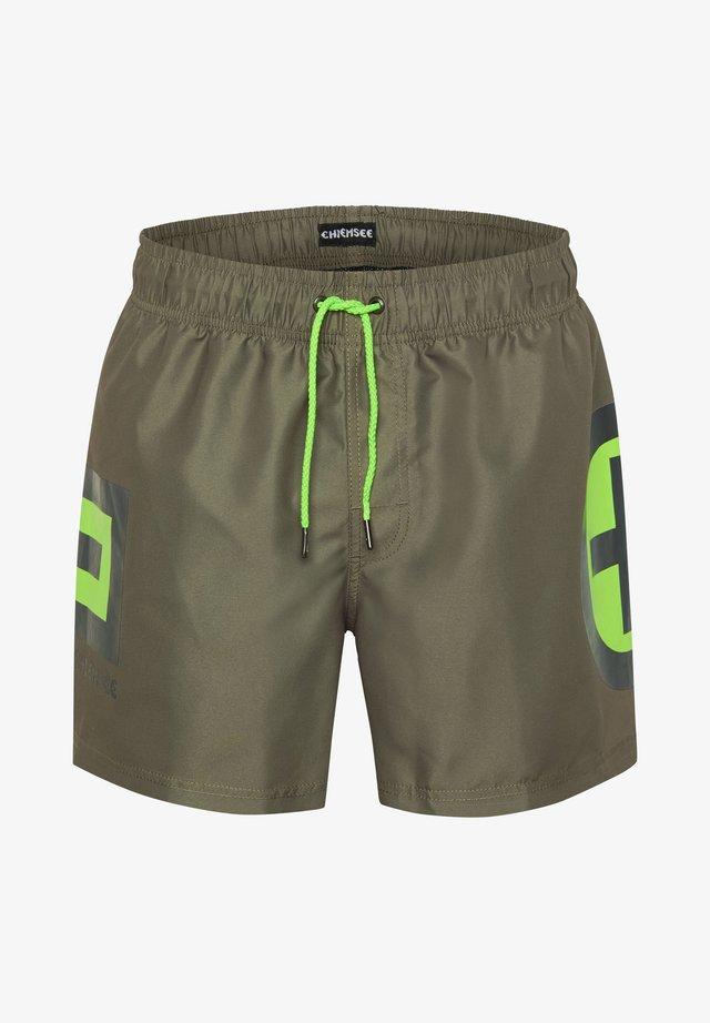 DRUCK - Swimming shorts - green